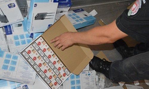 контрабанда сигарет в коробках из под роутеров
