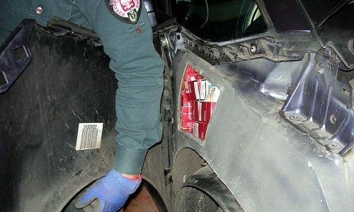 Спрятанные сигареты в кузове машины