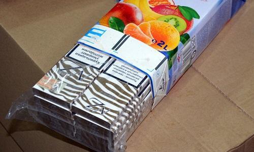 Сигареты в упаковке от сока