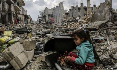 Руины в Сирии и ребенок