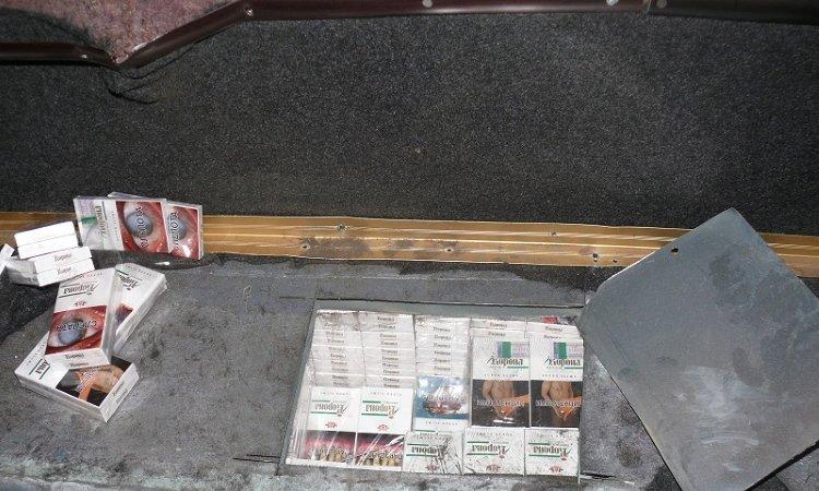 Сигареты в полу автобуса Неоплан